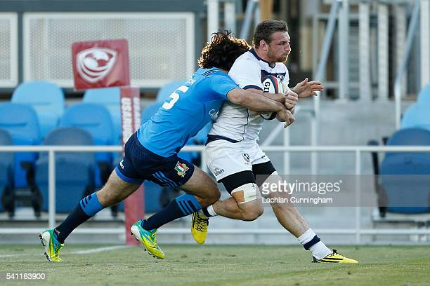 Tony Lamborn of the United States scores a try while being tackled by Luke McLean of Italy at Avaya Stadium on June 18 2016 in San Jose California