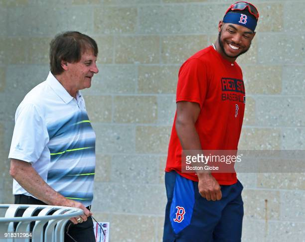 Tony LaRussa left executive vice president and special assistant to Dave Dombrowski chats with nonroster invitee Jesse Barfield right as they head...