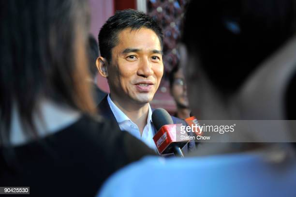 Tony Leung Hong Kong actor speaks to reporters at the opening of the 'Cartier Treasures' exhibition at the Forbidden City September 4 2009 in Beijing...