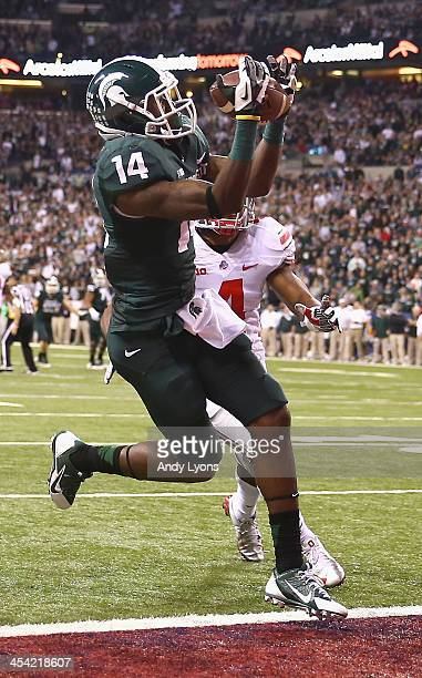 Tony Lippett of the Michigan State Spartans catches a touchdown pass in the second quarter over the defense of the Ohio State Buckeyes during the Big...