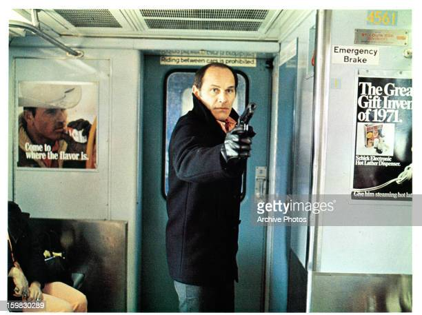 Tony Lo Bianco points a gun in a scene from the film 'The French Connection' 1971