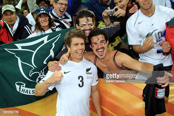 Tony Lochhead of New Zealand celebrates with a fan after holding Italy to a draw during the 2010 FIFA World Cup South Africa Group F match between...