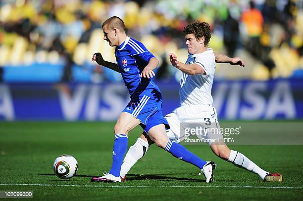 Tony Lochhead of New Zealand chases Vladimir Weiss of Slovakia during the 2010 FIFA World Cup South Africa Group F match between New Zealand and...