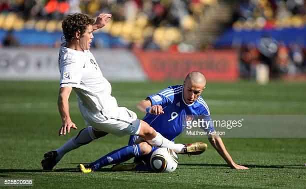 Tony Lochhead of New Zealand tackles Stanislav Sestak of Slovakia