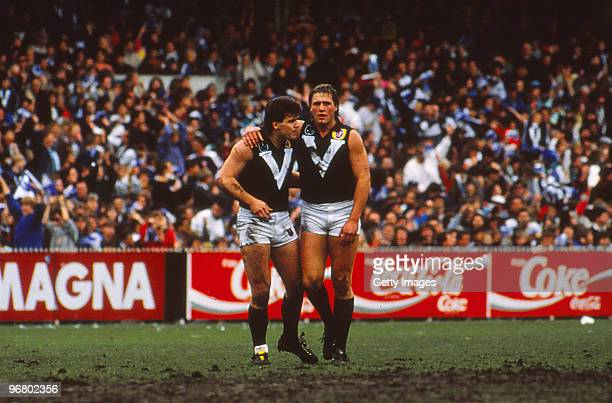Tony Lockett and Jason Dunstall of Victoria look on during an AFL State of Origin match between Victoria and South Australia at the MCG 1989 in...