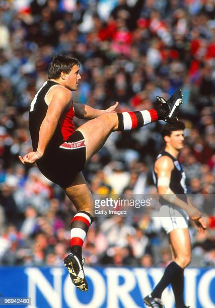 Tony Lockett of the Saints kicks a goal during the round 21 AFL match between St Kilda Saints and Carlton Blues 1992 in Melbourne Australia