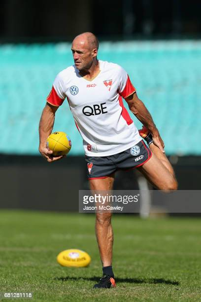 Tony Lockett of the Swans stretches during a Sydney Swans AFL training session at Sydney Cricket Ground on May 10 2017 in Sydney Australia