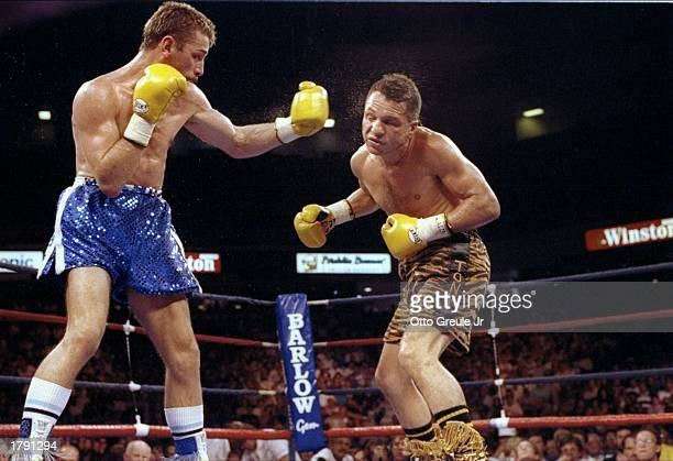 Tony Lopez and Brian Mitchell in action during a bout Mandatory Credit Otto Greule /Allsport