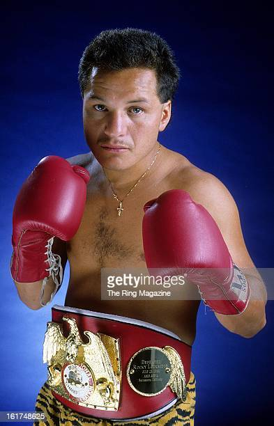 Tony Lopez poses with his belt for a portrait in New York