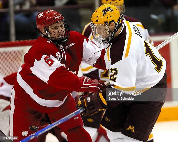 Tony Lucia of the Minnesota Gophers eyes the puck against Josh Engel of the Wisconsin Badgers on November 19 2006 at Mariucci Arena in Minneapolis...