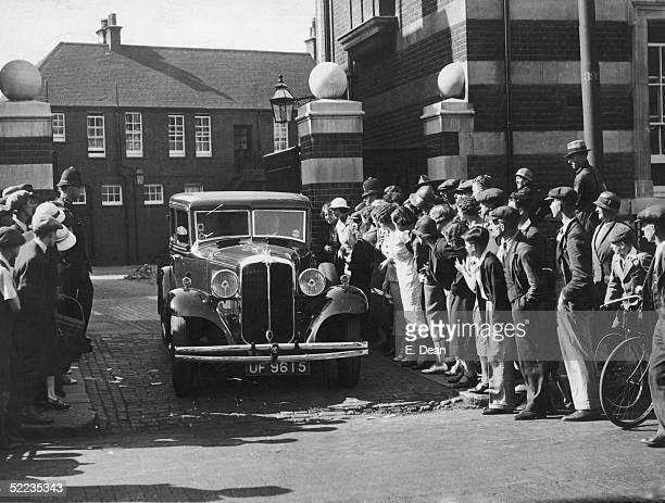 Tony Mancini leaves Lee Road Police Station London in a police car on the day of his arrest for the Brighton Trunk murders 17th July 1934 At his...