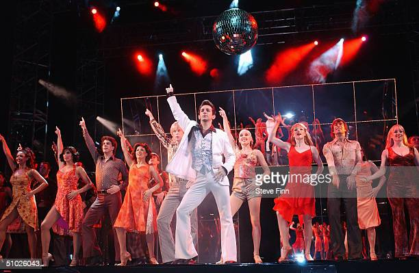 Tony Manero attends the photocall promoting the return of Saturday Night Fever to the West End after four years and two major UK tours at the Apollo...