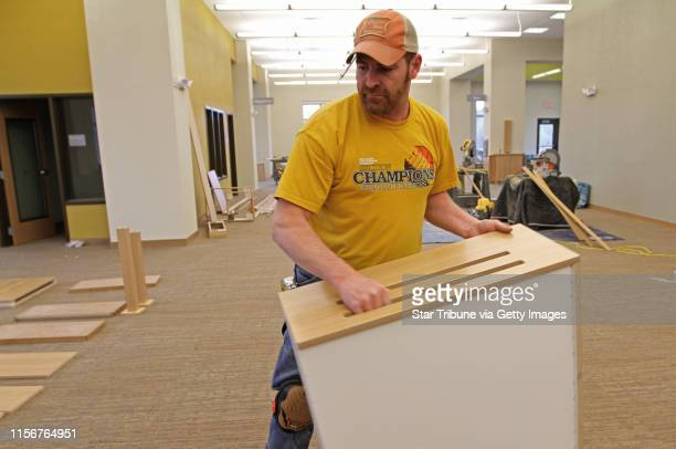 Tony Martin of Distinctive Cabinets of Foley MN., worked on the wood trim and cabinets at the new Scott County Library in Jordan MN. The new library...