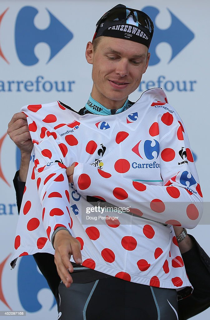 Tony Martin of Germany and the Omega Pharma - Quick-Step Cycling Team takes the podium to receive the king of the mountains jersey that he earned during his victory in stage nine of the 2014 Le Tour de France from Gerardmer to Mulhouse on July 13, 2014 in Mulhouse, France.