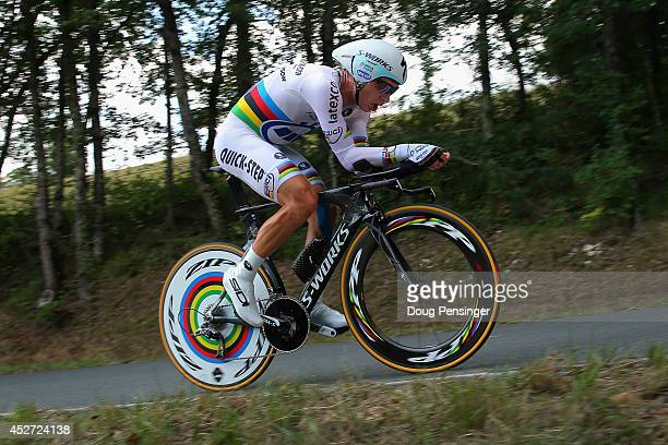 Tony Martin of Germany and the Omega Pharma QuickStep Cycling Team races to first place in the individual time trial during the twentieth stage of...