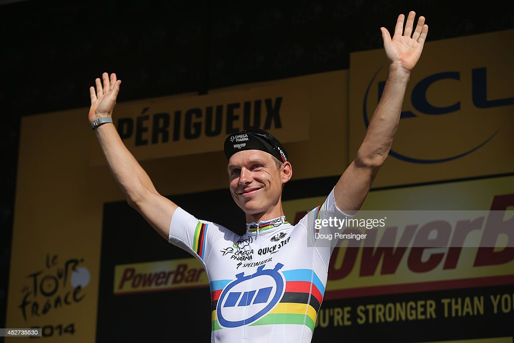 Tony Martin of Germany and the Omega Pharma - Quick-Step Cycling Team celebrates on the podium after winning the individual time trial during the twentieth stage of the 2014 Tour de France, a 54km individual time trial stage between Bergerac and Perigueux, on July 26, 2014 in Perigueux, France.