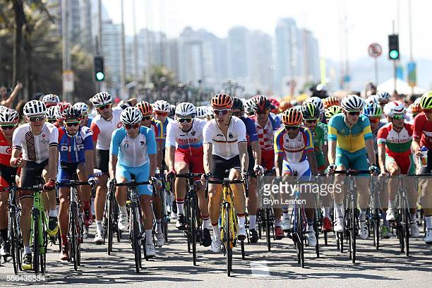 Tony Martin of Germany rides in the peloton near Copacabana beach during the Men's Road Race on Day 1 of the Rio 2016 Olympic Games at the Fort...