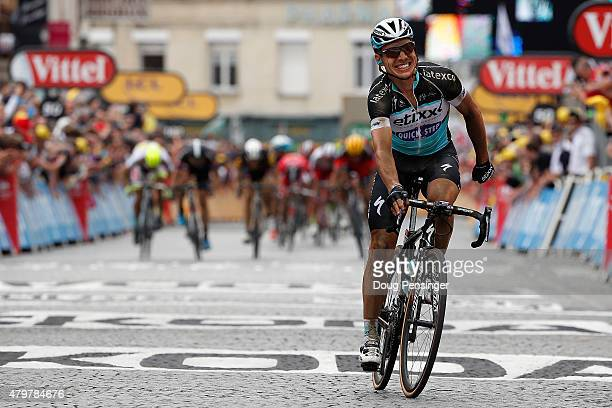 Tony Martin of Germany riding for EtixxQuickStep celebrates ahead of a charging peloton as he wins stage four of the 2015 Tour de France from Seraing...