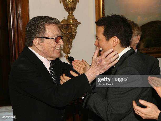 Tony Martin talks to Michael Feinstein during his wedding with Terrence Flannery held at a private residence on October 17 2008 in Los Angeles...