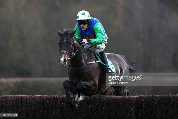 Tony McCoy and Pauillac clear an early fence before landing The Arena Leisure pLC Beginners Chase Race run at Lingfield Racecourse on November 28 in...