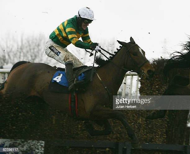 Tony McCoy and Specular clear the last fence before landing The COLNE HBLB Novices Chase Race run at Huntingdon Racecourse on February 24 2005 in...