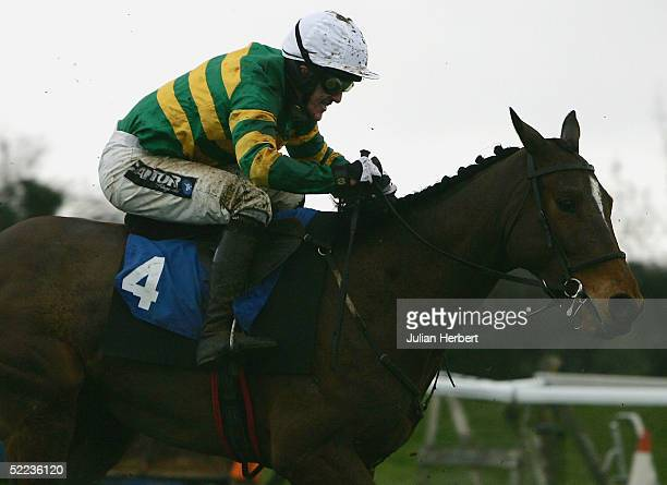 Tony McCoy and Specular pull away from the last fence before landing The COLNE HBLB Novices Chase Race run at Huntingdon Racecourse on February 24...