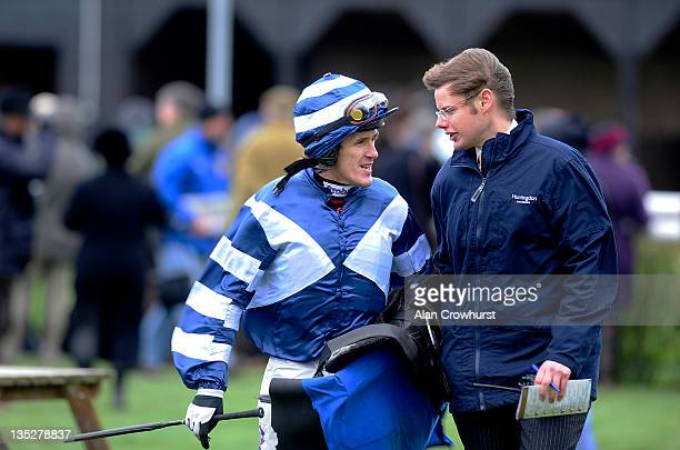 Tony McCoy chats with Clerk of The Course Andrew Morris about the strong winds at Huntingdon racecourse on December 08 2011 in Huntingdon England