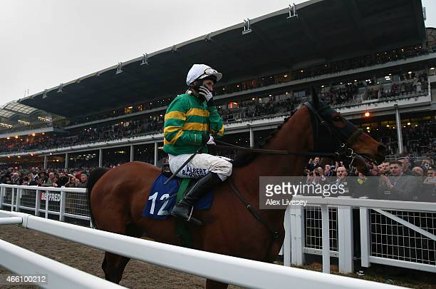 Tony McCoy looks emotional as he passes in front of the grandstand on Ned Buntline after finishing his last race at Cheltenham in the AP McCoy Grand...