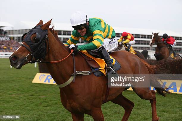 Tony McCoy on Uxizandre con his way to victory in the Ryanair Steeplechase during day three of the Cheltenham Festival at Cheltenham Racecourse on...