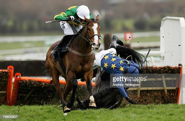 Tony McCoy rides Wichita Lineman to victory as Ruby Walsh parts company from Black Hary during The Brit Insurance Novices Hurdle Race on the final...