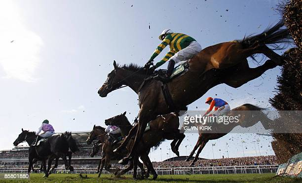 Tony McCoy riding Don't Push It clears a barrier following two false starts during the Grand National Steeple Chase on the third day of the Grand...