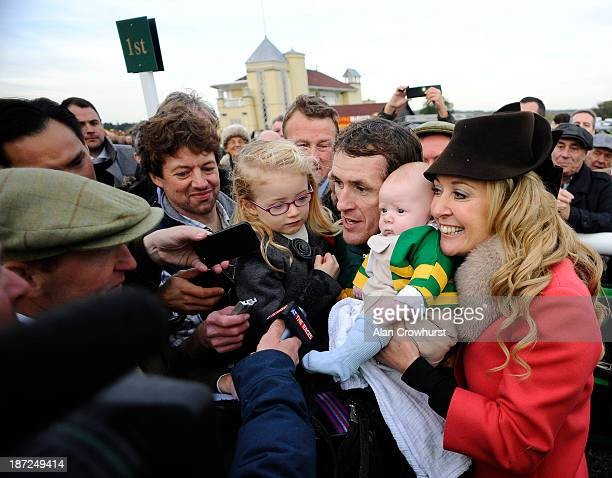 Tony McCoy riding Mountain Tunes celebrates victory to give Tony McCoy his 4000th career win in The Weatherbys Novices' Hurdle Race with daughter Eve...