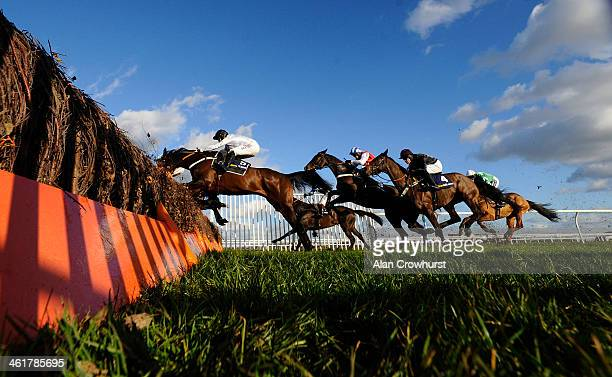 Tony McCoy riding Royal Boy on their way to winning The williamhillcom Tolworth Hurdle Race at Kempton Park racecourse on January 11 2014 in Sunbury...