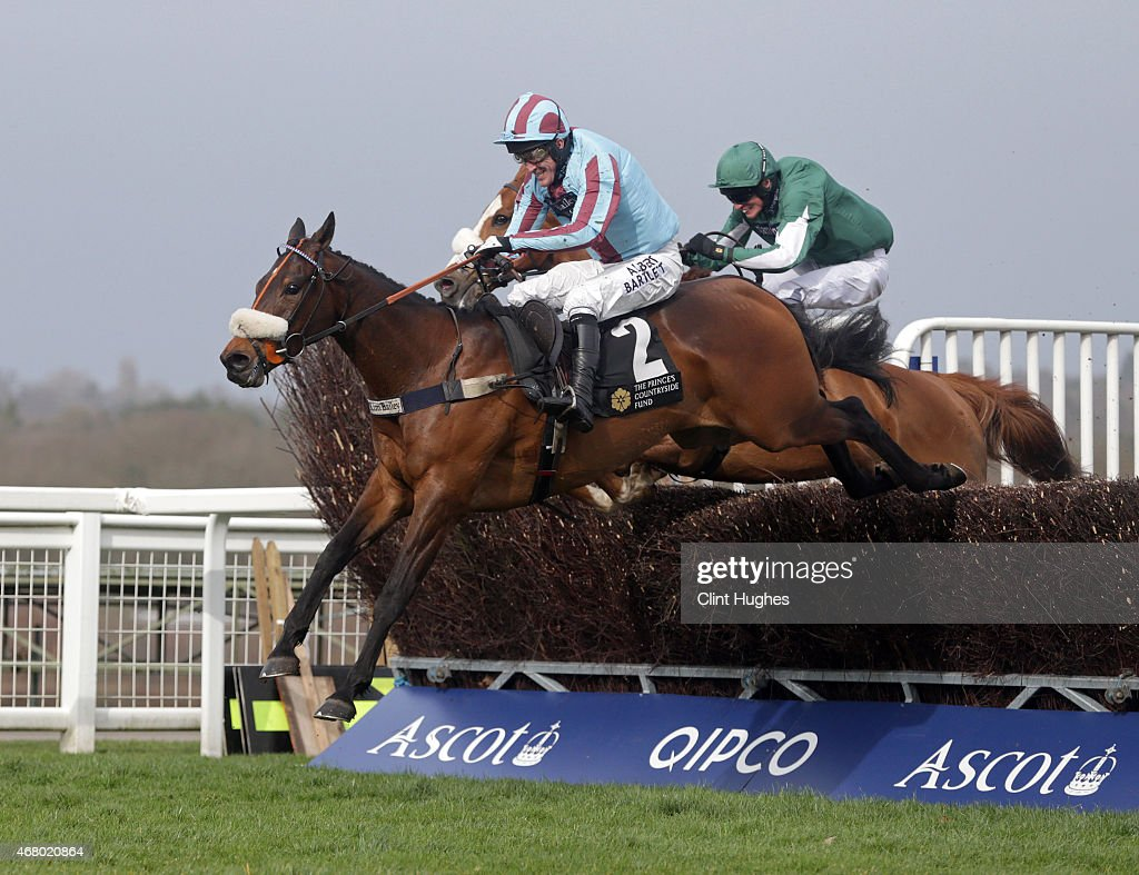 Tony McCoy riding Un Ace clears the last fence and wins the Waitrose Novices' Handicap Steeple Chase at Ascot Racecourse on March 29, 2015 in Ascot, England.