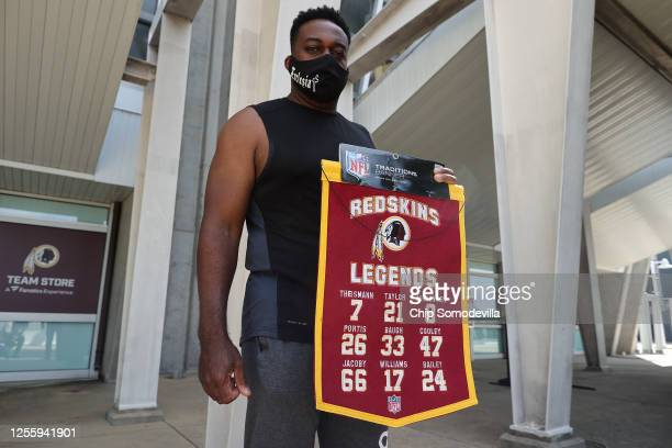 Tony McGhee of Baton Rouge Louisiana poses with the banner he purchased at the Fan Store at FedEx Field home of the NFL's Washington Redskins team...