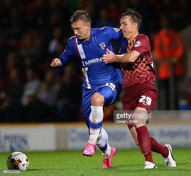 Tony McMahon of Bradford City AFC and Luke Norris of Gillingham FC compete for possession during the Sky Bet League One match between Bradford City...