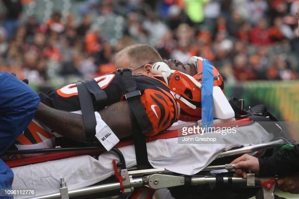 Tony McRae of the Cincinnati Bengals is carted off of the field after suffering a concussion during the game against the Cleveland Browns at Paul...