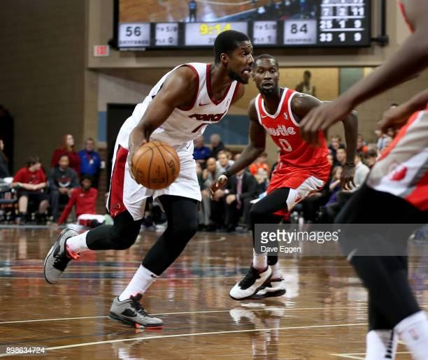 Tony Mitchell of the Sioux Falls Skyforce drives to the basket past Trahson Burrell of the Memphis Hustle during an NBA GLeague game on December 25...