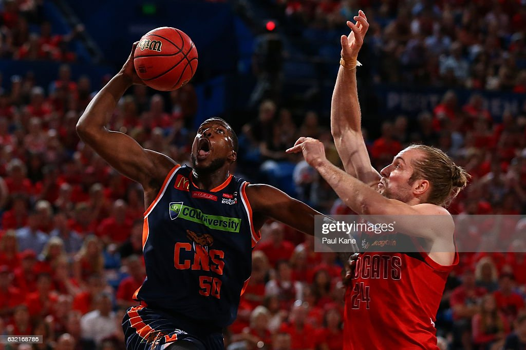 Tony Mitchell of the Taipans lays up against Jesse Wagstaff of the Wildcats during the round 16 NBL match between the Perth Wildcats and the Cairns Taipans at Perth Arena on January 20, 2017 in Perth, Australia.