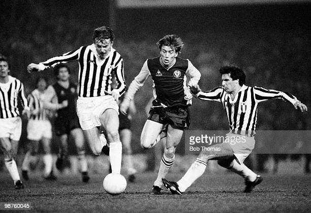 Tony Morley of Aston Villa is challenged by Gaetano Scirea and Zbigniew Boniek of Juventus during the European Cup Quarterfinal 1st leg match held at...