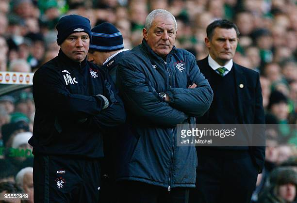 Tony Mowbray coach of Celtic and Walter Smith and Ally McCoist of Rangers watch from the dug outs during the Scottish Premier League match between...
