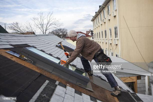 Tony Murray and a group of volunteer carpenters from Dublin Ireland help renovate a private residence January 17 2013 flooded and damaged during...