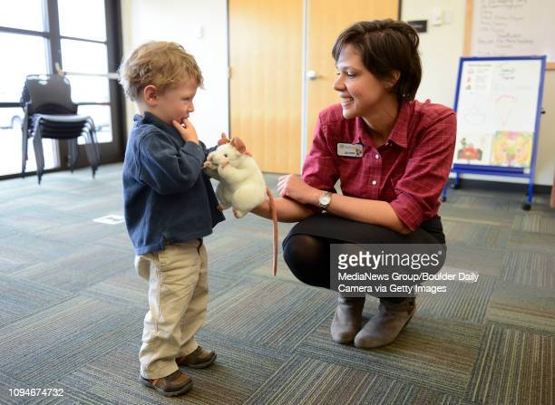 Tony Musco pets Fiona a toy rat held by library associate Allison Knoecklein before the start of Tales for Tots at the Erie Library 400 Powers St...