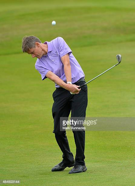 Tony Newman of John O'Gaunt Golf Club plays a chip shot during the first round of the Lombard Trophy Grand Final at Gleneagles on September 2 2014 in...