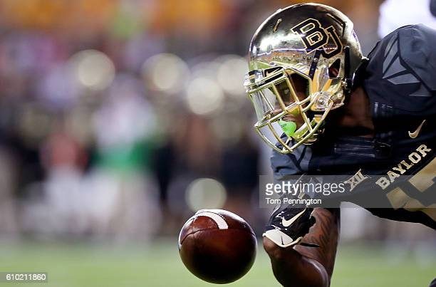 Tony Nicholson of the Baylor Bears fumbles the ball against the Oklahoma State Cowboys in the first half at McLane Stadium on September 24 2016 in...