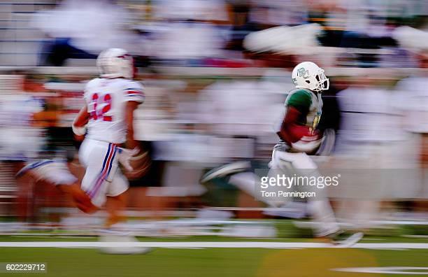Tony Nicholson of the Baylor Bears returns a punt against RC Cox of the Southern Methodist Mustangs in the seconf half at McLane Stadium on September...