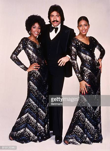 Tony Orlando and Dawn Left to right Joyce Vincent Wilson Tony Orlando and Thelma Hopkins pose together Joyce and Thelma wearing black with silver...