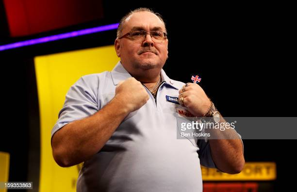 Tony O'Shea of England celebrates winning his semi final match against Wesley Harms of the Netherlands on day eight of the BDO Lakeside World...