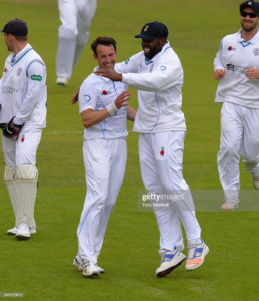 Tony Palladino of Derbyshire celebrates with Chesney Hughes of Derbyshire after bowling out Tom Kohler-Cadmore of Worcestershire during the Specsavers County Championship: Division Two match between Derbyshire and Worcestershire at The 3aaa County Ground on June 22, 2016 in Derby, England.