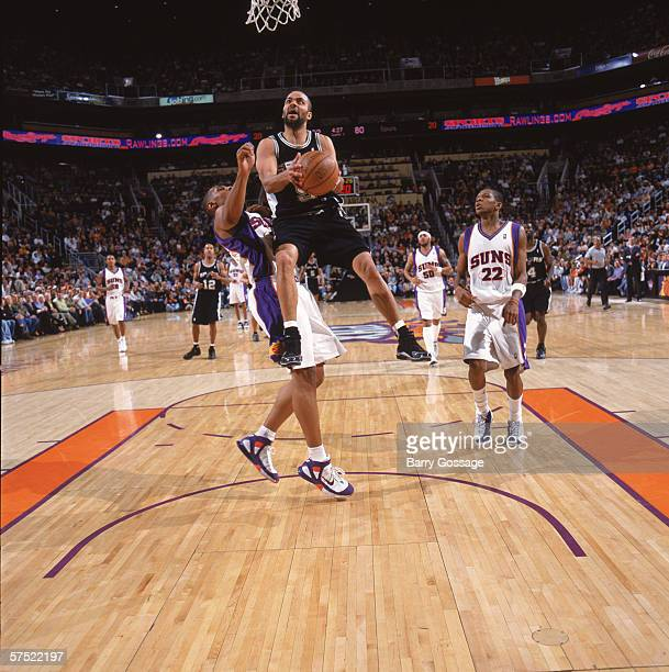Tony Parker 39 of the San Antonio Spurs shoots against Boris Diaw of the Phoenix Suns during the game at the US Airways Center in Phoenix Arizona on...
